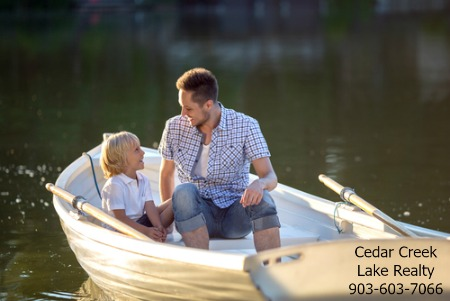 man and son in boat
